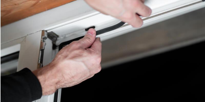 changing garage door seal - Mr. Garage Door Repairman